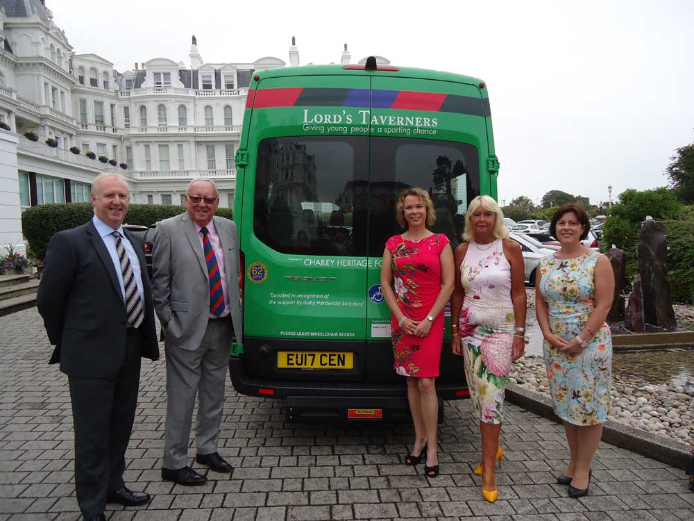 David Getty, Bob 'The Cat' Bevan MBE, Cara Sheppard, Laura Collins and Melanie Verth with the Chailey Heritage Foundation minibus