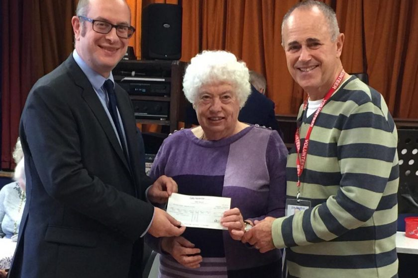 Partner Richard Ostle presents a cheque for the Marsham Older People's Project (MOPP)