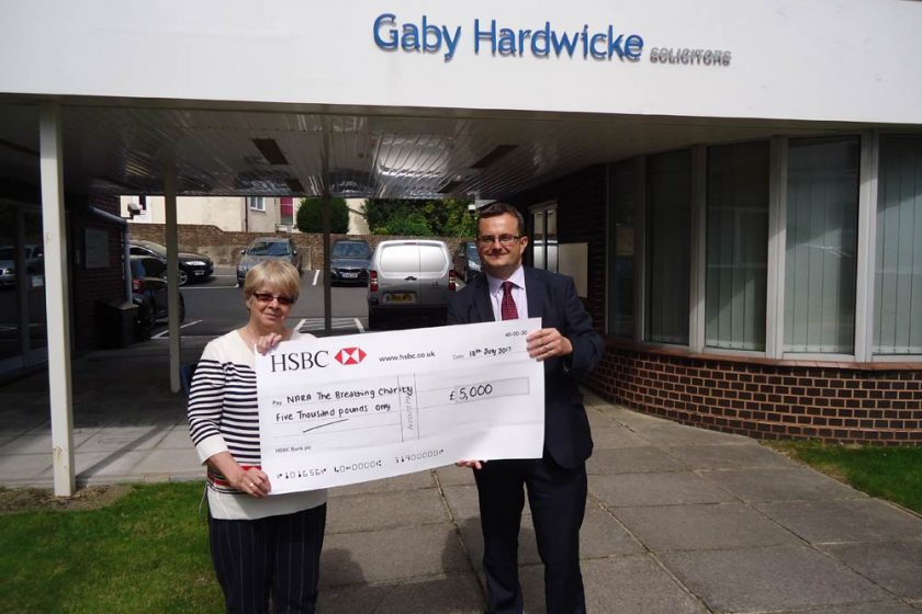 Antony Caulfield presents a cheque to Ann Jiggle of NARA