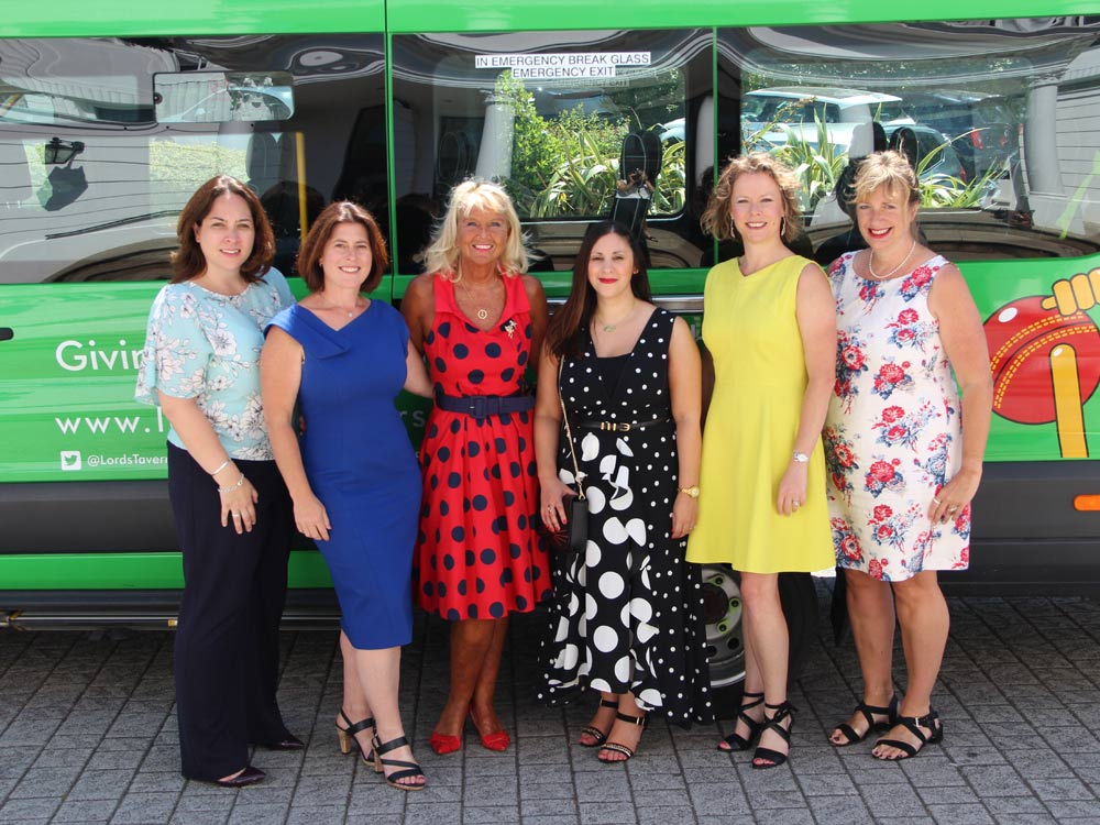Our representatives and Laura Collins with a Lord's Taverners minibus