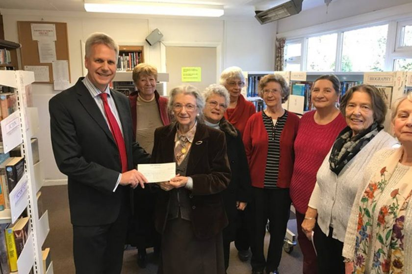 David Young presents the Little Common Library donation cheque