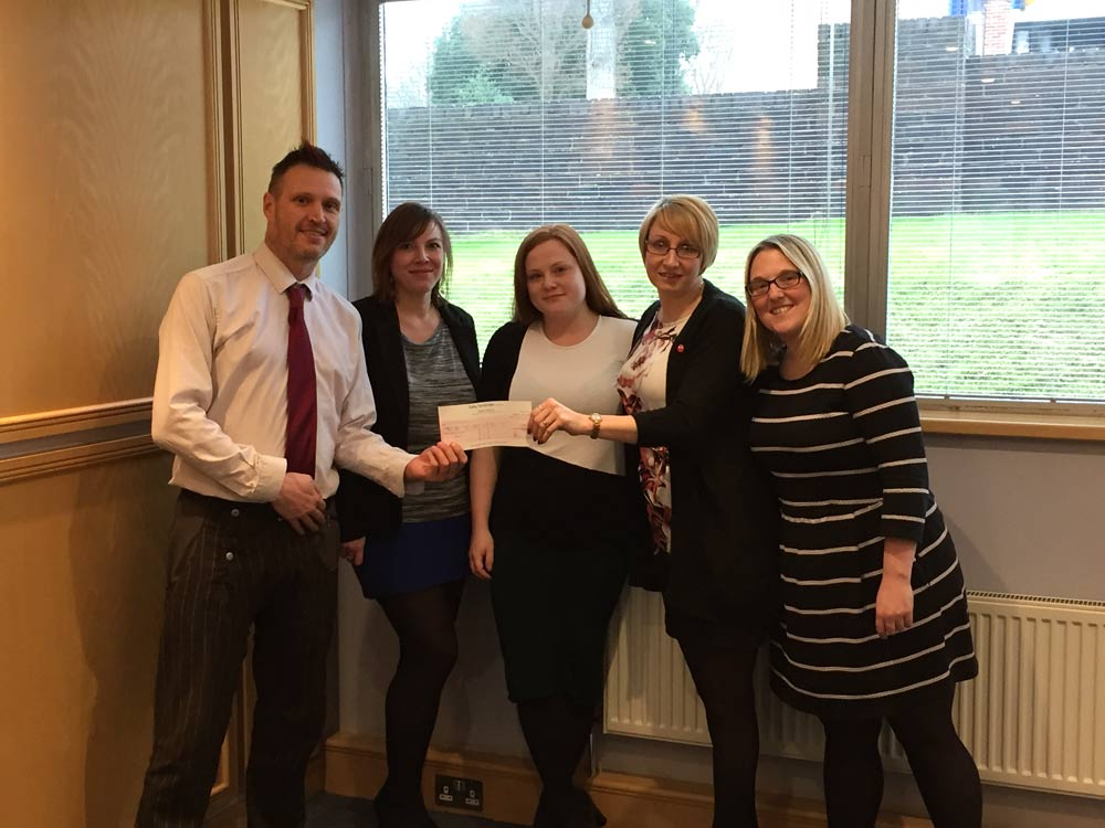 The GH team present their sponsorship cheque to Simon Cosham, Fundraising Manager at St Wilfrid's Hospice