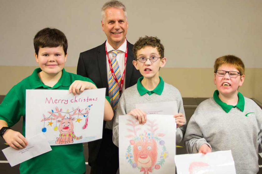 David Young, with Felix, Toby and Oscar holding the winning entries